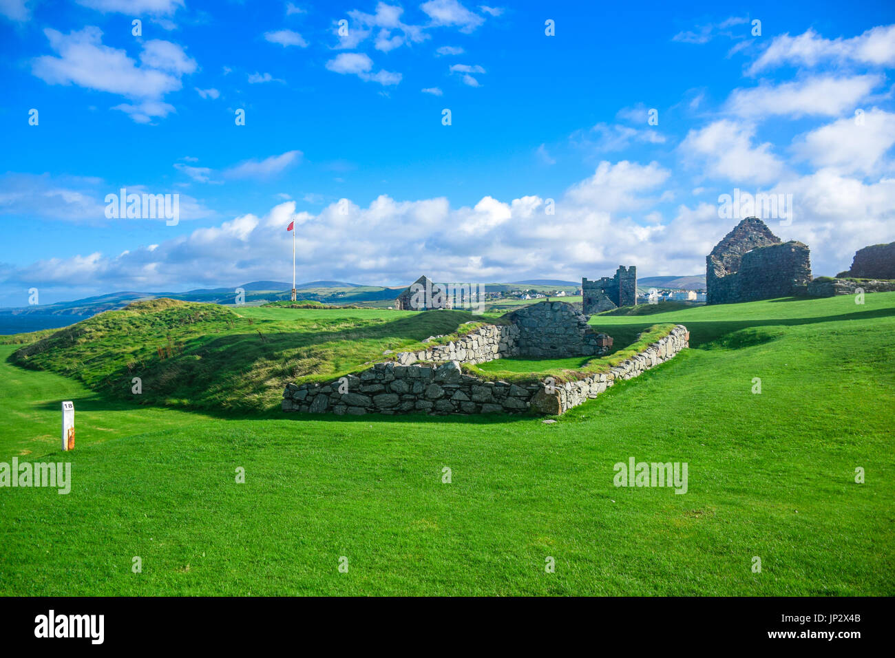 Scenery view of Peel Castle constructed by vikings on top of Peel hill on a clear blue sky, Isle of Man - Stock Image