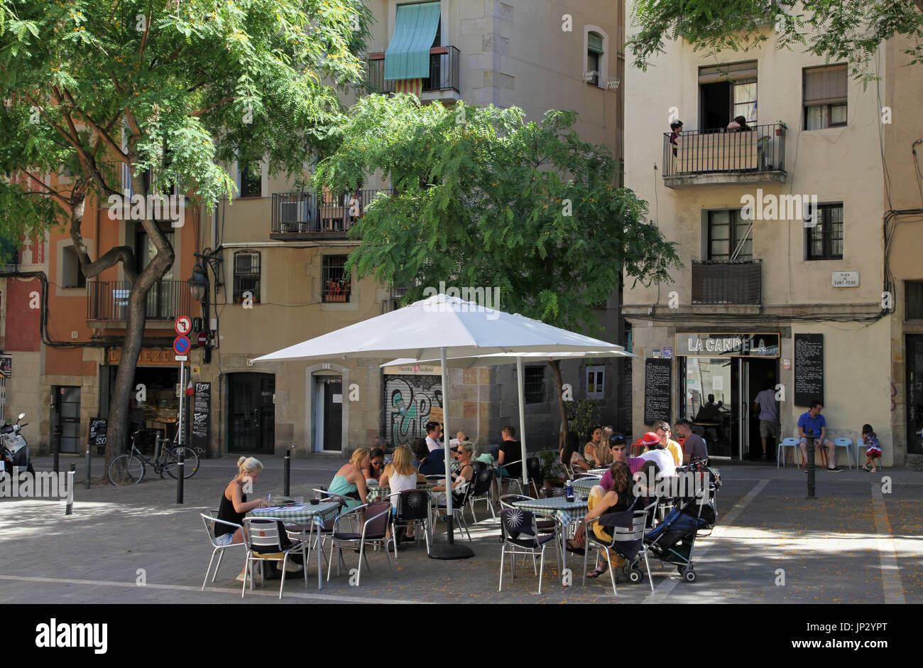 Outdoor cafe and tourists at La Candela Restaurant in Barcelona.Placa de Sant Pere.Spain - Stock Image