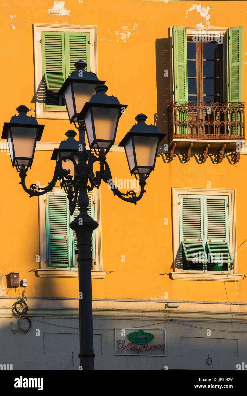 Sardinia Sassari piazza, colourful wall of a house in the Piazza d'Italia at sunset, Sassari, Sardinia. - Stock Image