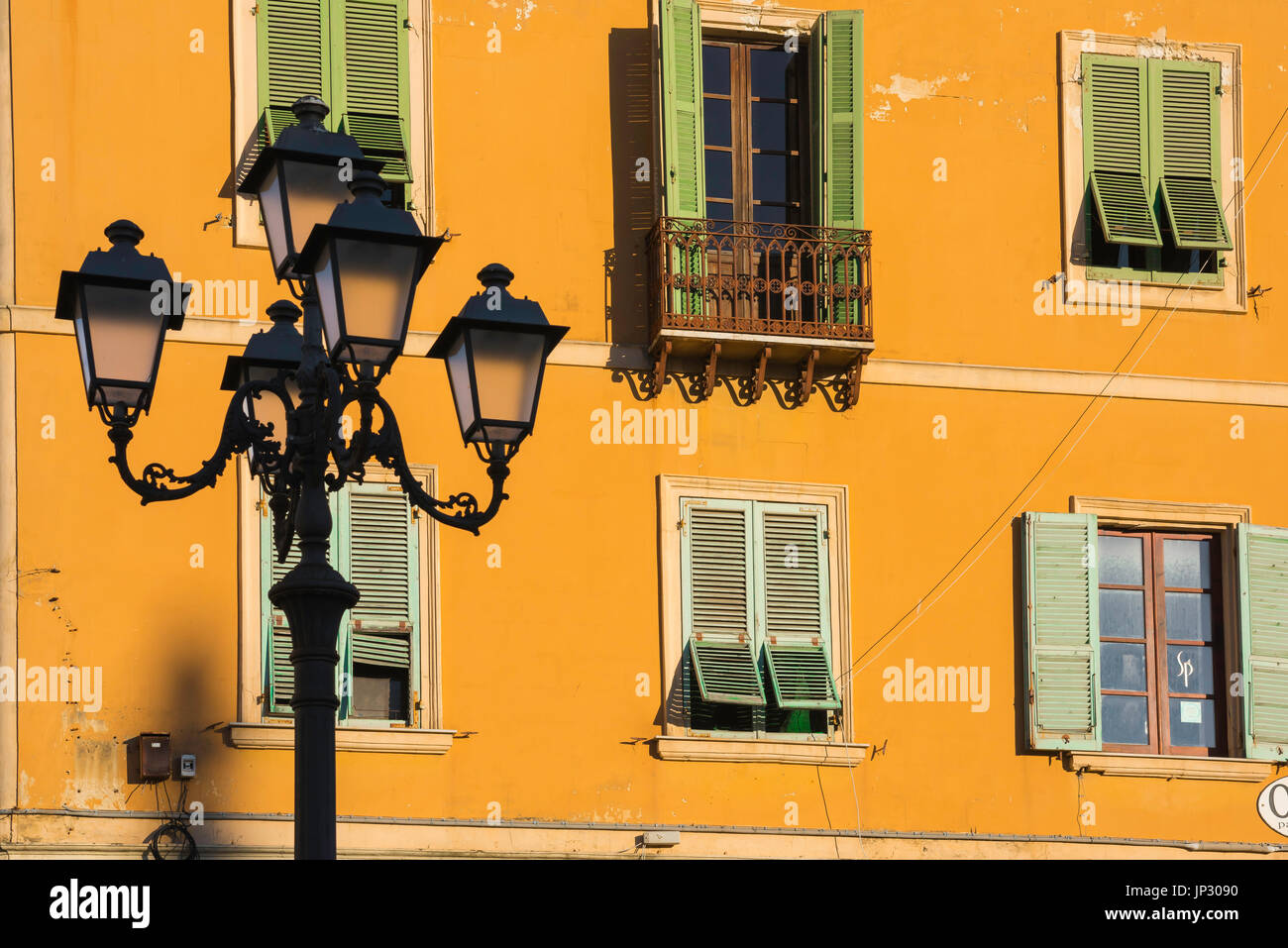 Sardinia colour house, colourful wall of a house in the Piazza d'Italia at sunset, Sassari, Sardinia. - Stock Image
