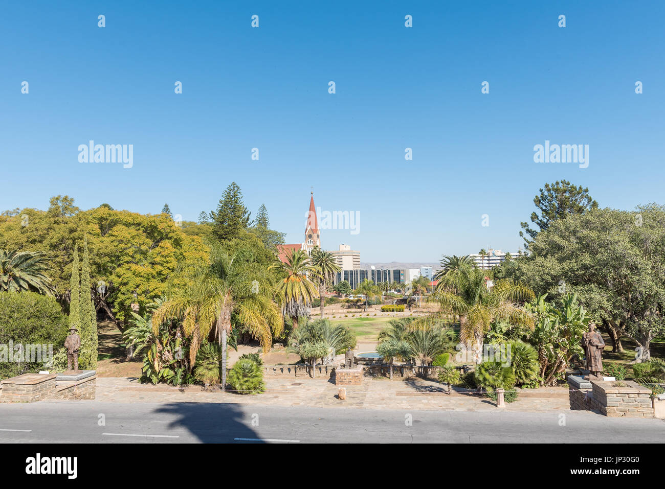 WINDHOEK, NAMIBIA - JUNE 17, 2017: Gardens at the Tintenpalast , the Namibian parliament building in Windhoek. Statues of Hendrik Samuel Witbooi Hosea - Stock Image