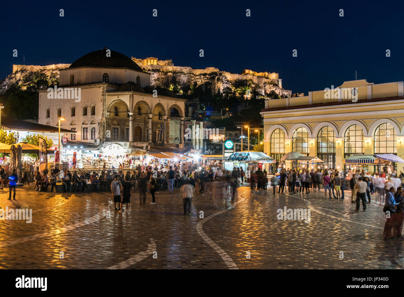 Night view of Monastiraki square with Acropolis in the background, Athens, Attica, Greece - Stock Image