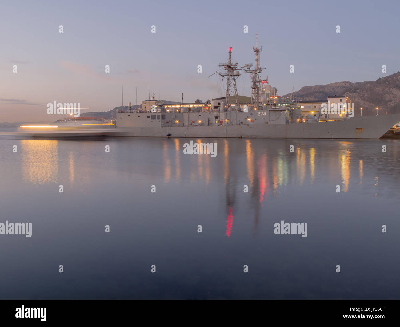 Bergen, Norway - February 12, 2017:  Navy ships in the port of Bergen at night - Stock Image