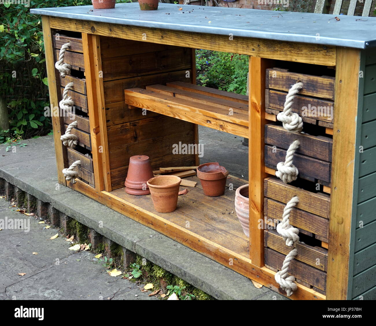 Unique and unusual garden storage unit with drawer handles made
