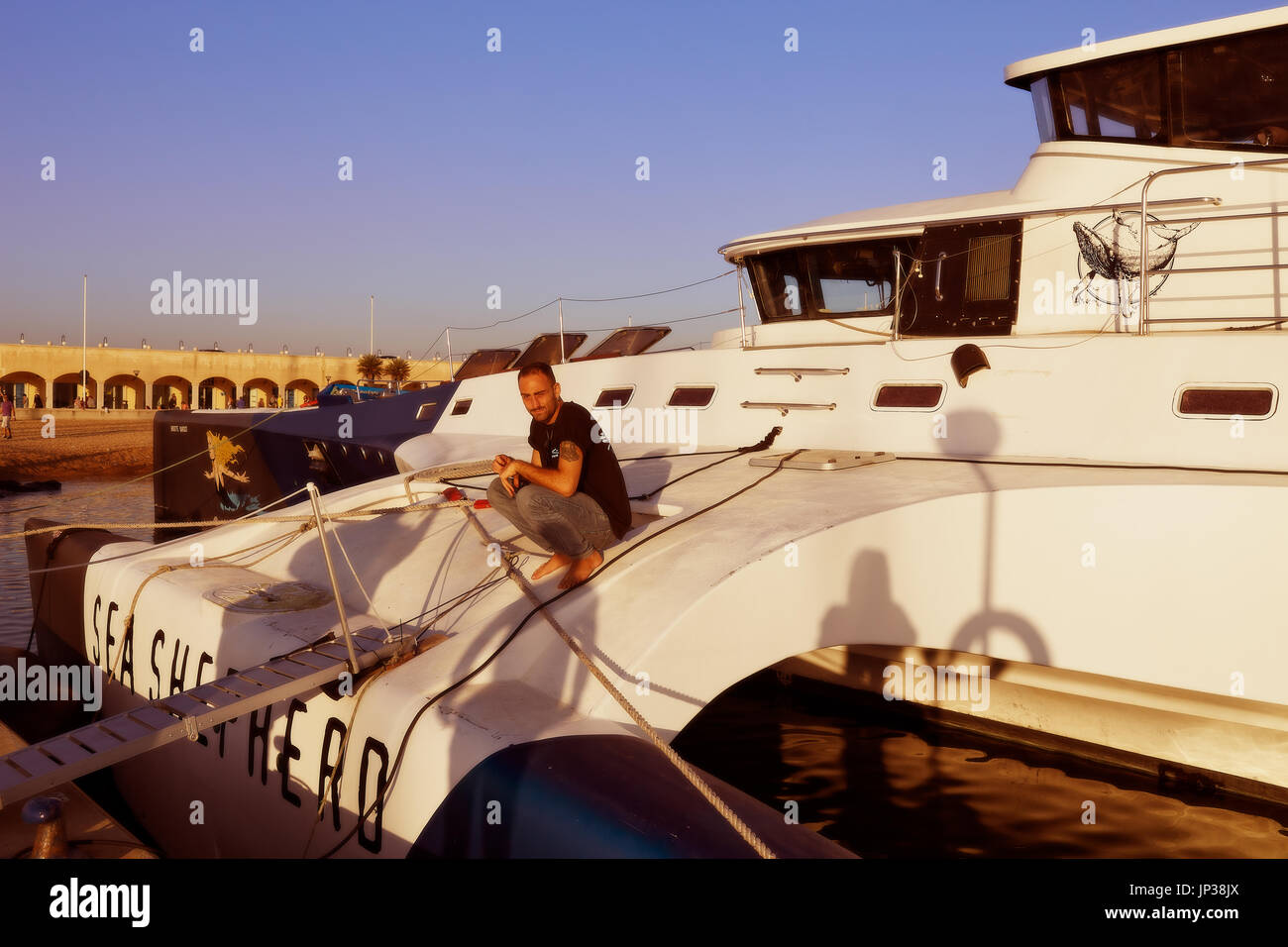 OSTIA, LAZIO, ITALY - OCTOBER 18, 2014: The trimaran of Sea Shepherd Brigitte Bardot docks in the port of Ostia. - Stock Image