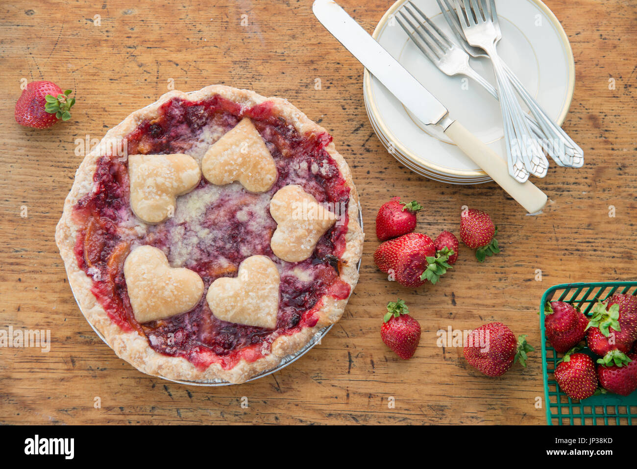 Heart shaped dough on berry pie ready to serve - Stock Image
