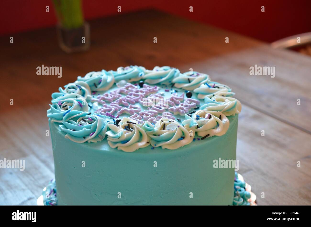 UNC birthday cake on wooden tabletop - Stock Image
