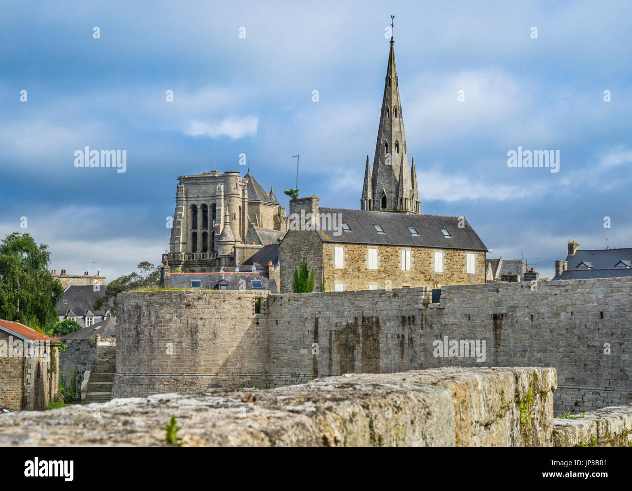 France, Brittany, Cotes-d'Armor department, Guingamp, Chateau de Pierre II was part of the city rampards, in the background the Basilica Notre Dame de - Stock Image