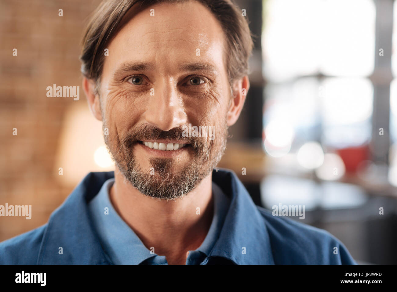 Portrait of nice optimistic courier - Stock Image