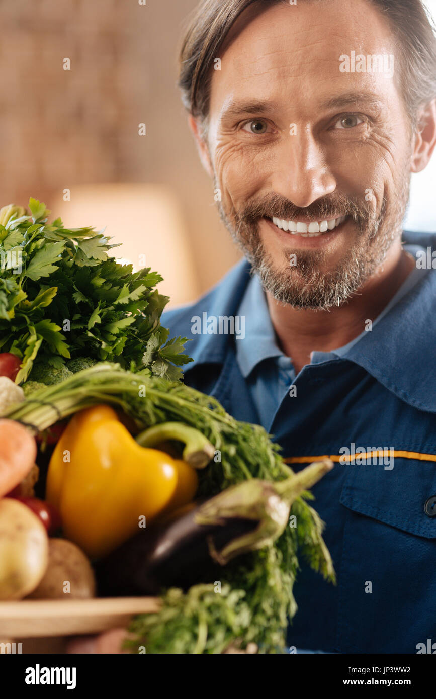 Charming energetic man loving what he doing - Stock Image