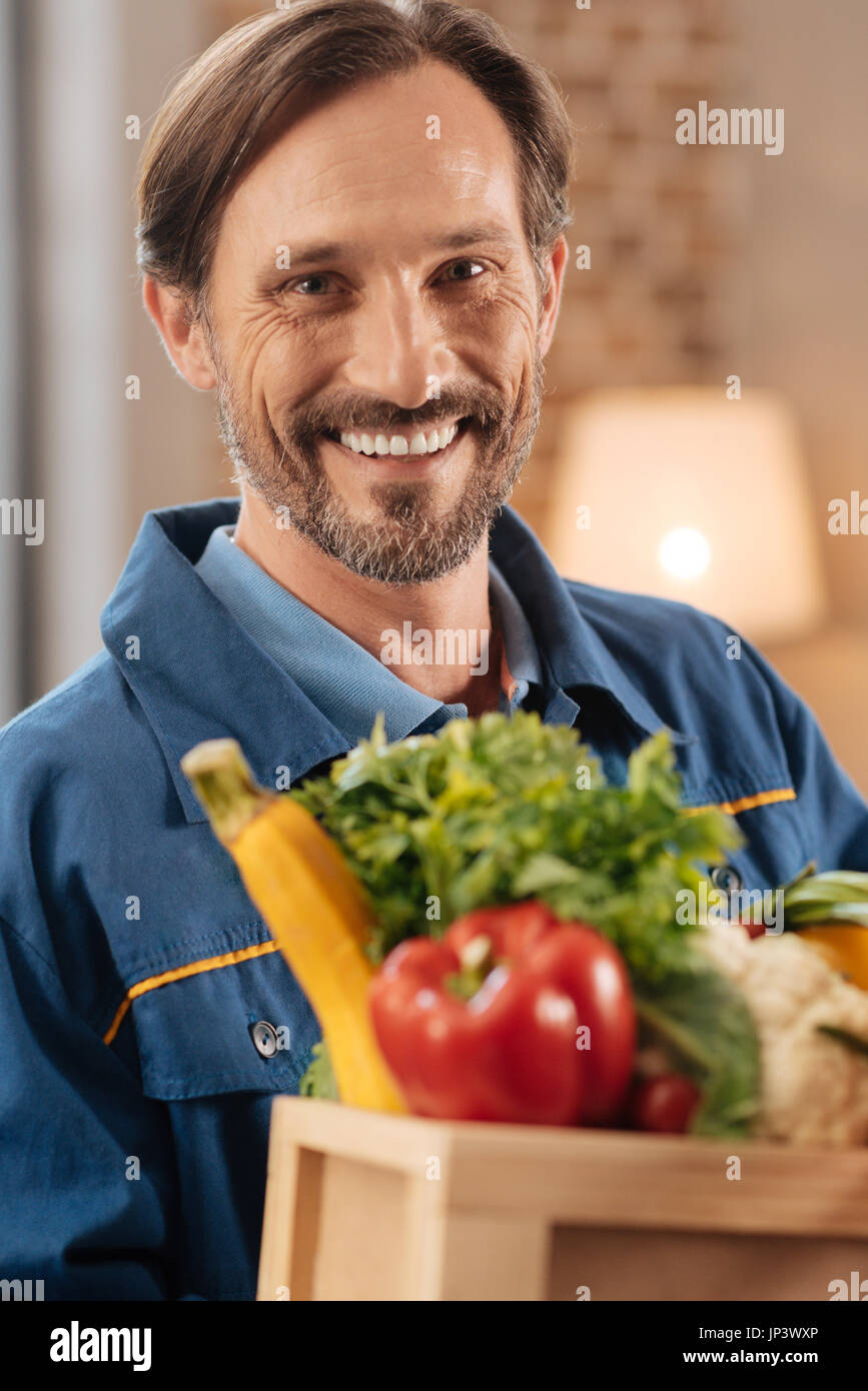 Active attractive man glad helping people - Stock Image