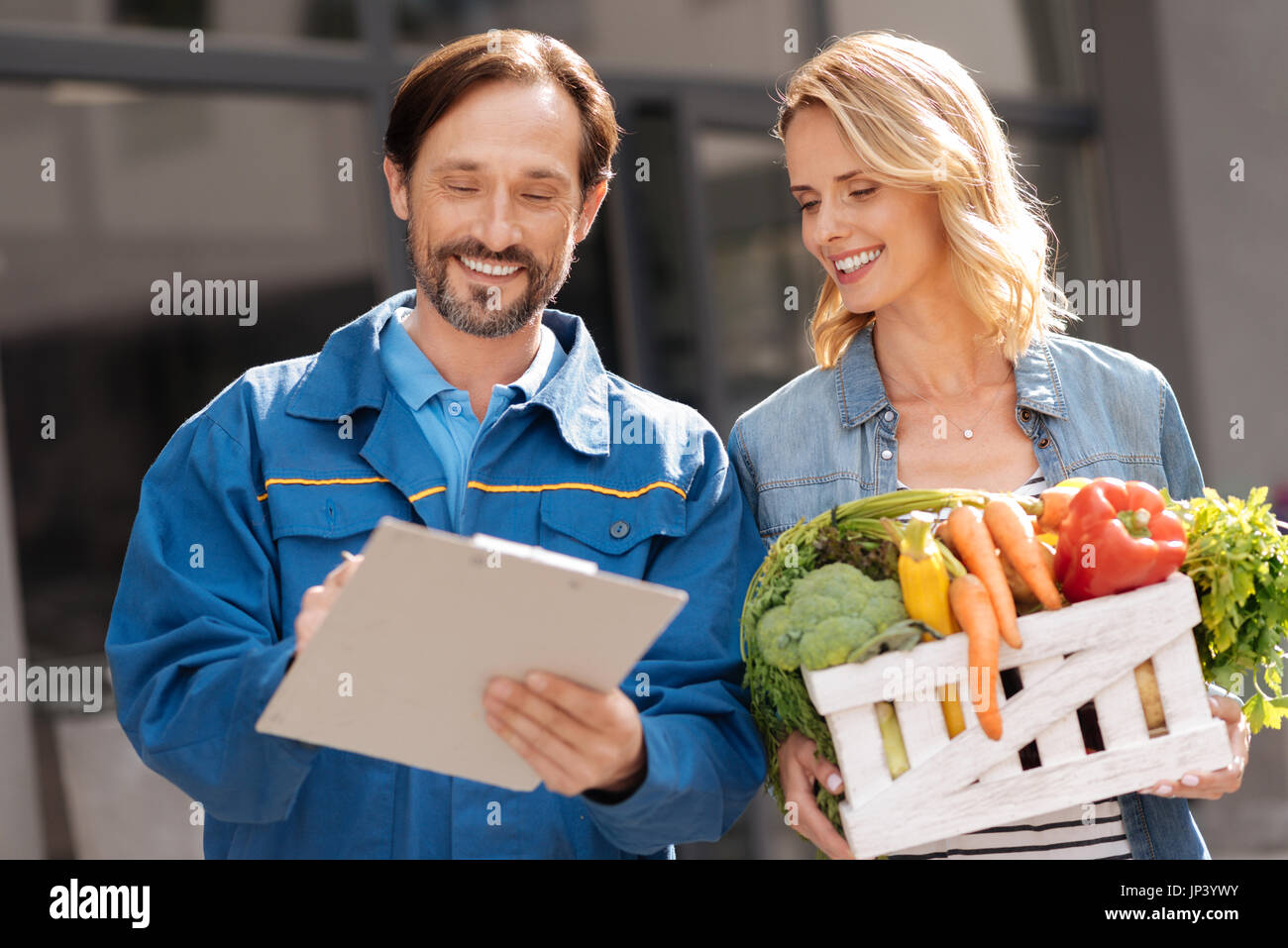 Scrupulous professional courier checking with the list Stock Photo