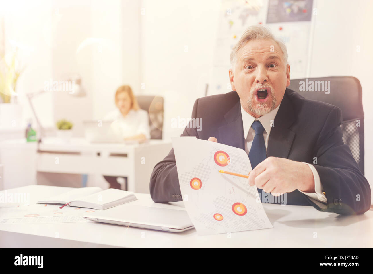 Serious irritated businessman furious about the mistake - Stock Image