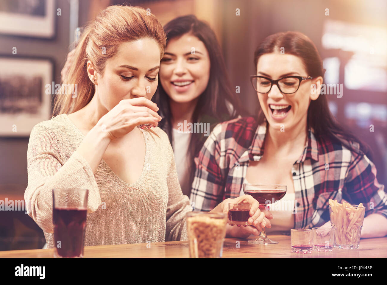 Two brunettes expressing positivity on faces - Stock Image