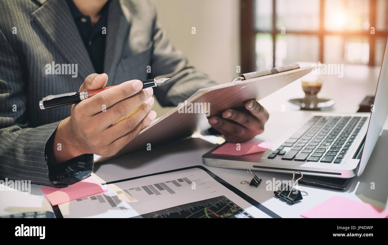 Audit concept,Bookkeeper or financial inspector and secretary making report Financial Planning Report in Spreadsheet .Internal revenue Service inspect - Stock Image