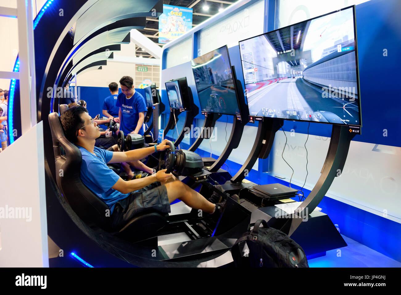 PS4 videHong Kong - July 29, 2017: People play to Playstation 4 videogames. The 19th Ani-Com & Games Hong Kong 2017 at the Hong Kong Convention & Exhi - Stock Image