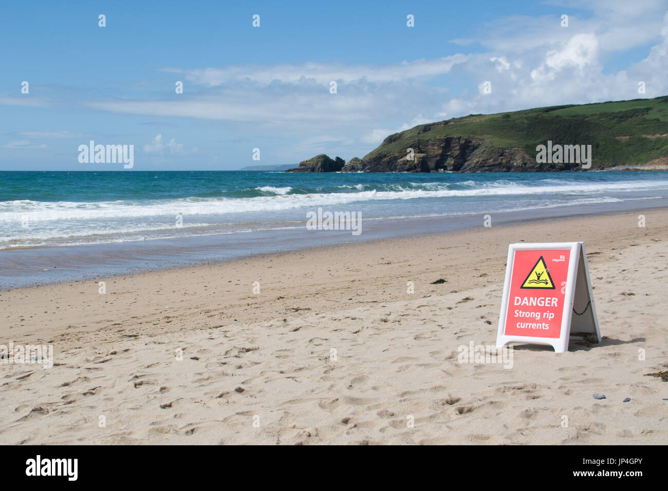 Danger strong rip currents sign on beach - Stock Image