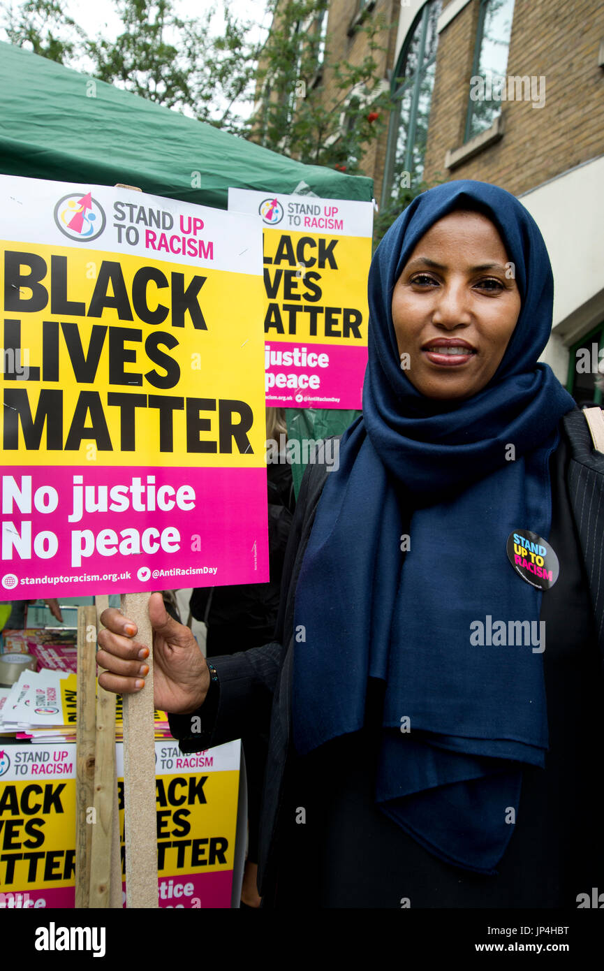 Rakhia Ismail at a rally,outside Stoke Newington police station, Hackney, after the death of  20 year old Rashan Charles who died on 22n - Stock Image