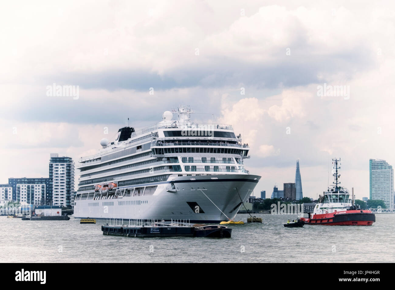 UK,London,MV Viking Sea Cruise ship moored at Greenwich on the river Thames with Shard and buildings in background.Cruise Stock Photo