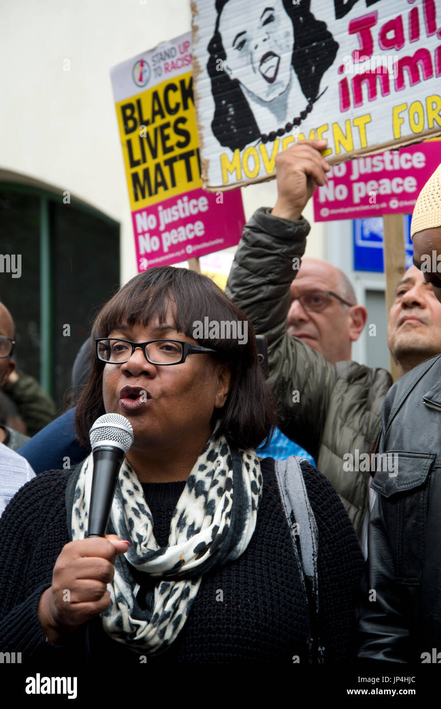 Diane Abbott speaks at a rally, outside Stoke Newington police station,  after the death of  20 year old Rashan Charles who died on 22nd July - Stock Image