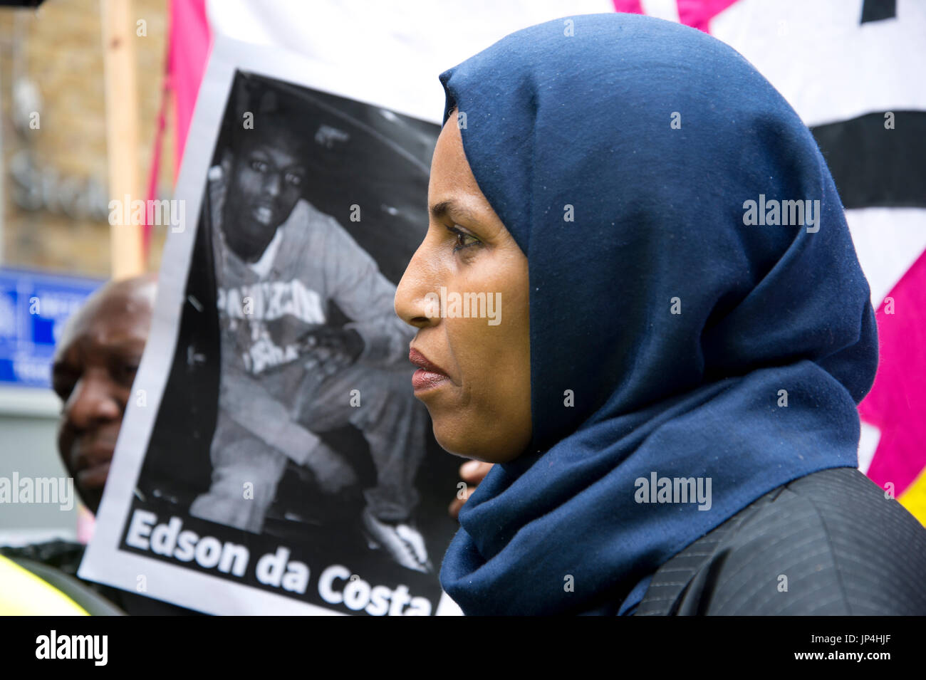 Rakhia Ismail speaks at a rally outside Stoke Newington police station, Hackney, after 20 year old Rashan Charles died  22nd July 2017. - Stock Image