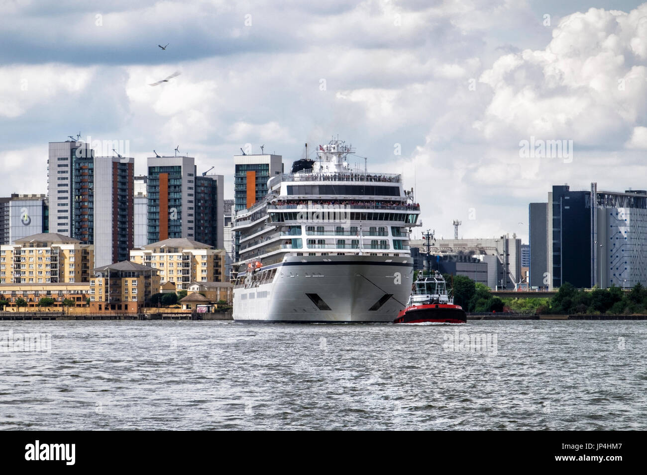 UK,London,MV Viking Sea cruise ship with people on deck as it leaves the city. Cruise liner leaves London. River Thames - Stock Image