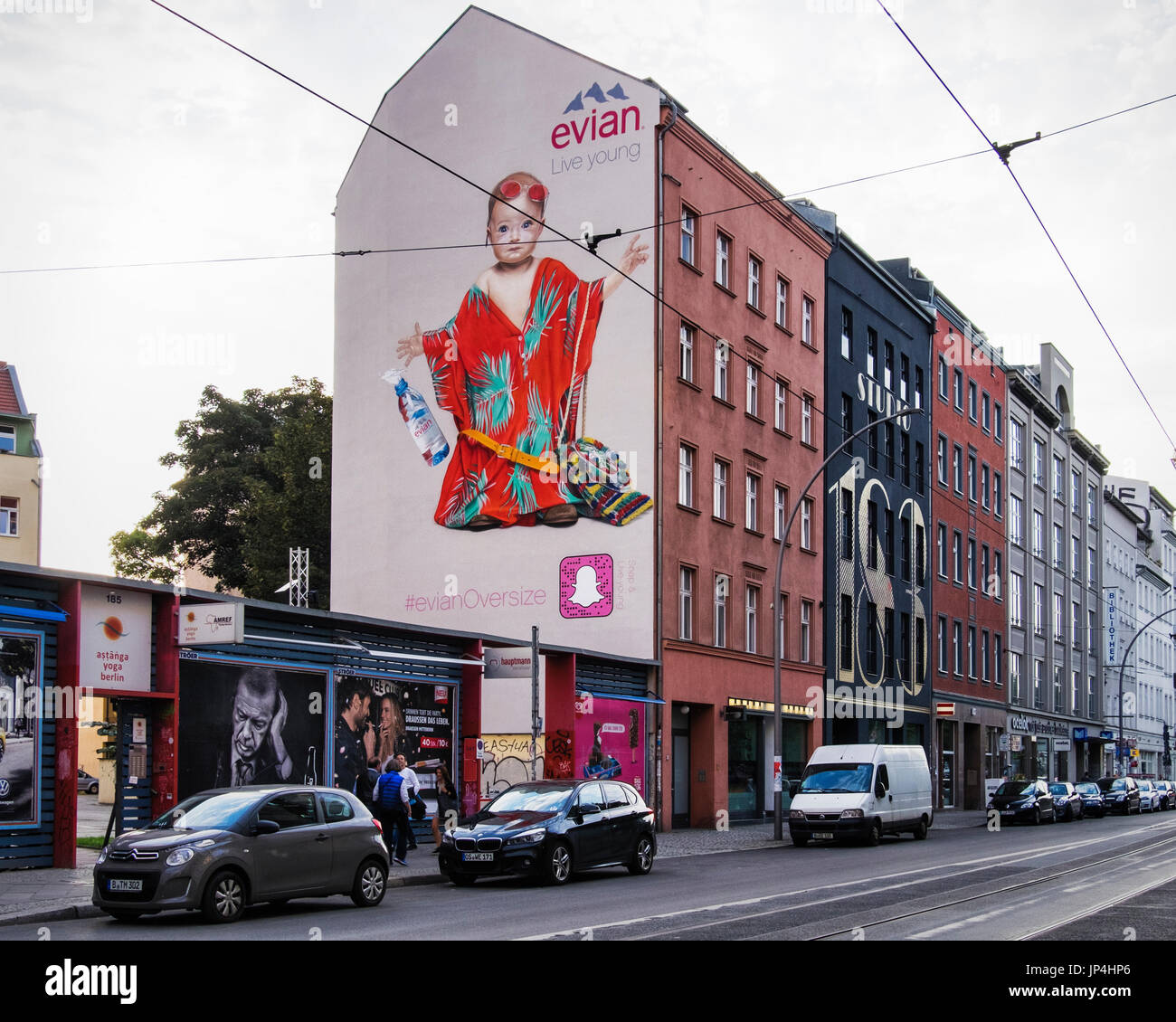 Berlin Mitte,Brunnestrasse. Giant mural advertisement advertising Evian Water on side of apartment building. Commercial art - Stock Image