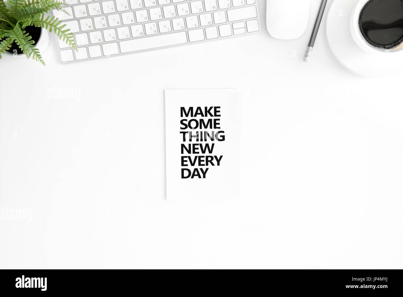flat lay with make something new every day motivational quote in diary, computer mouse and keyboard isolated on white - Stock Image