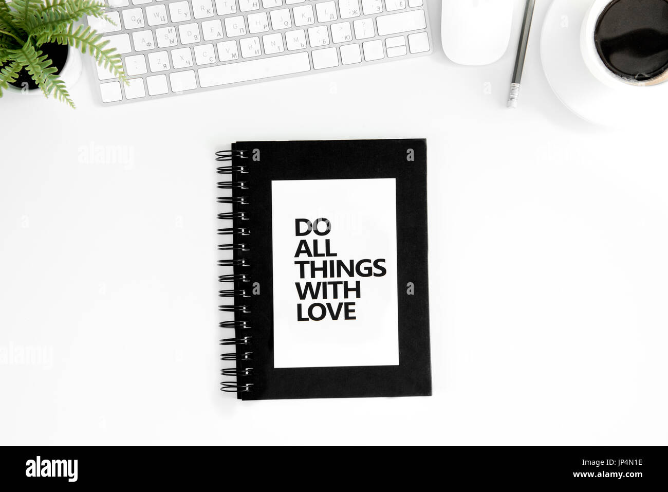 Top view of do all things with love motivational quote, computer mouse and keyboard isolated on white - Stock Image