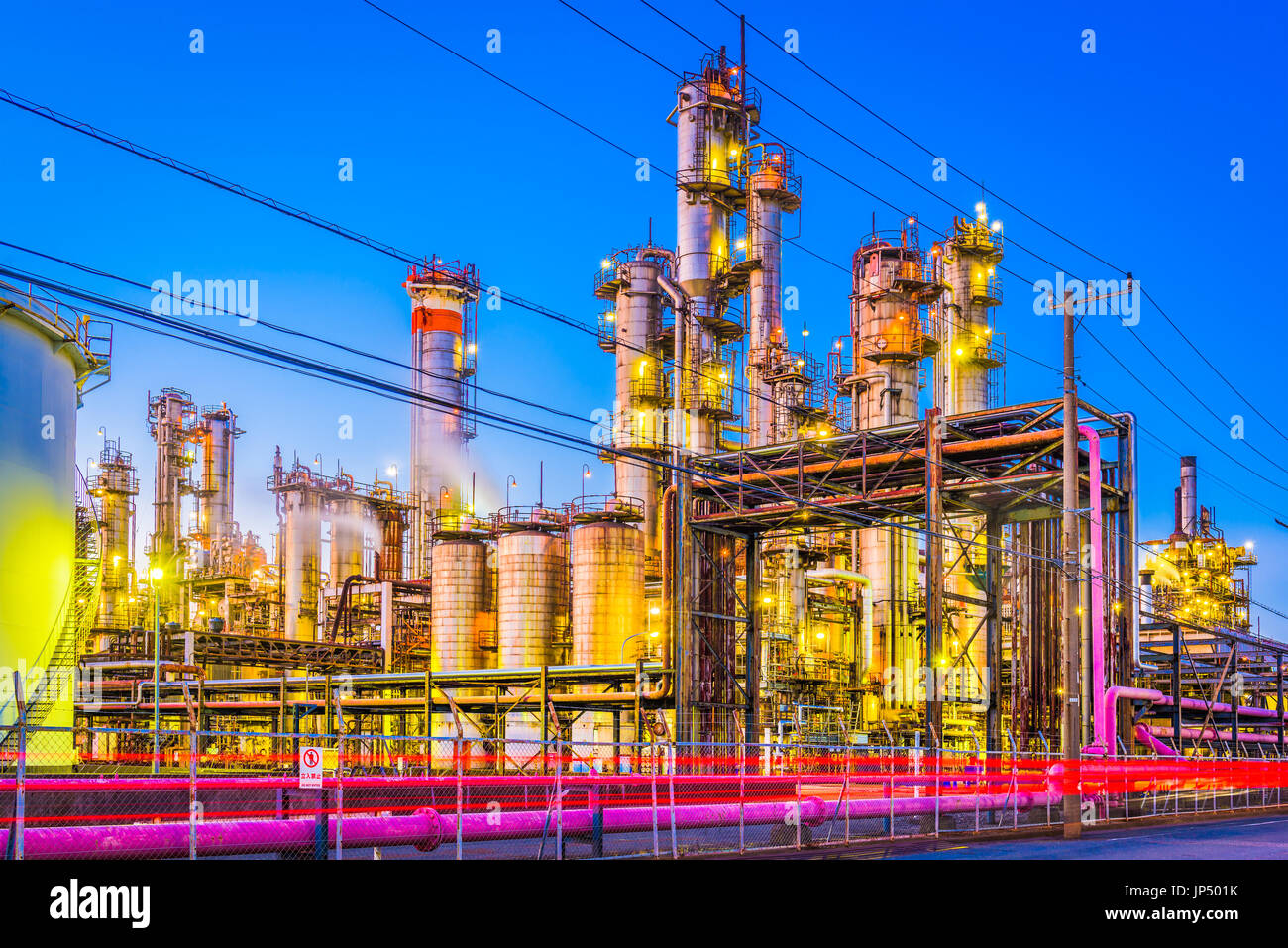Factories at twilight in Japan. - Stock Image