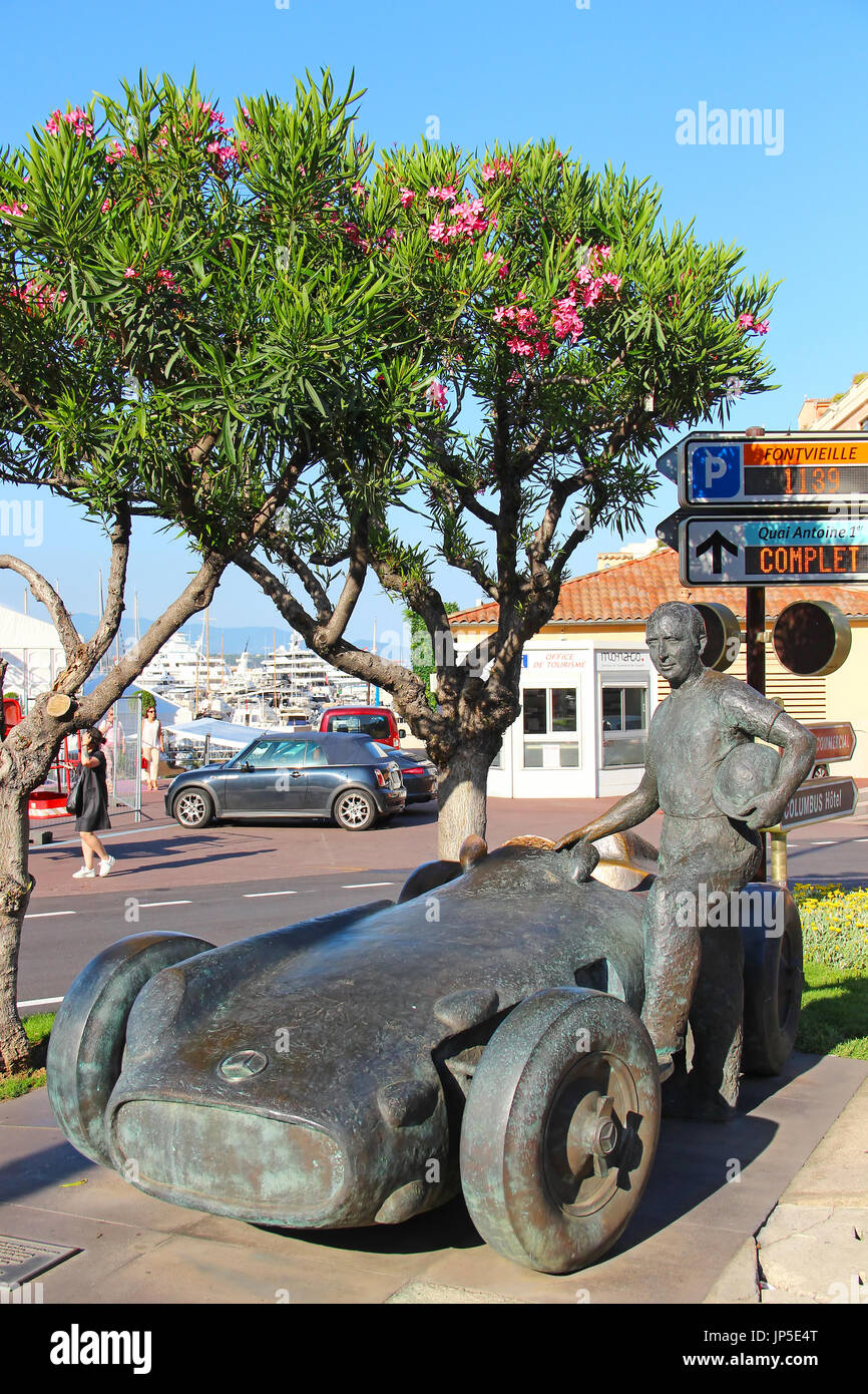 MONACO - JUNE 24, 2016: Juan Manuel Fangio memorial at the Grand Prix circuit in Monaco. The statue depicts the 5-time Formula One World Champion stan - Stock Image