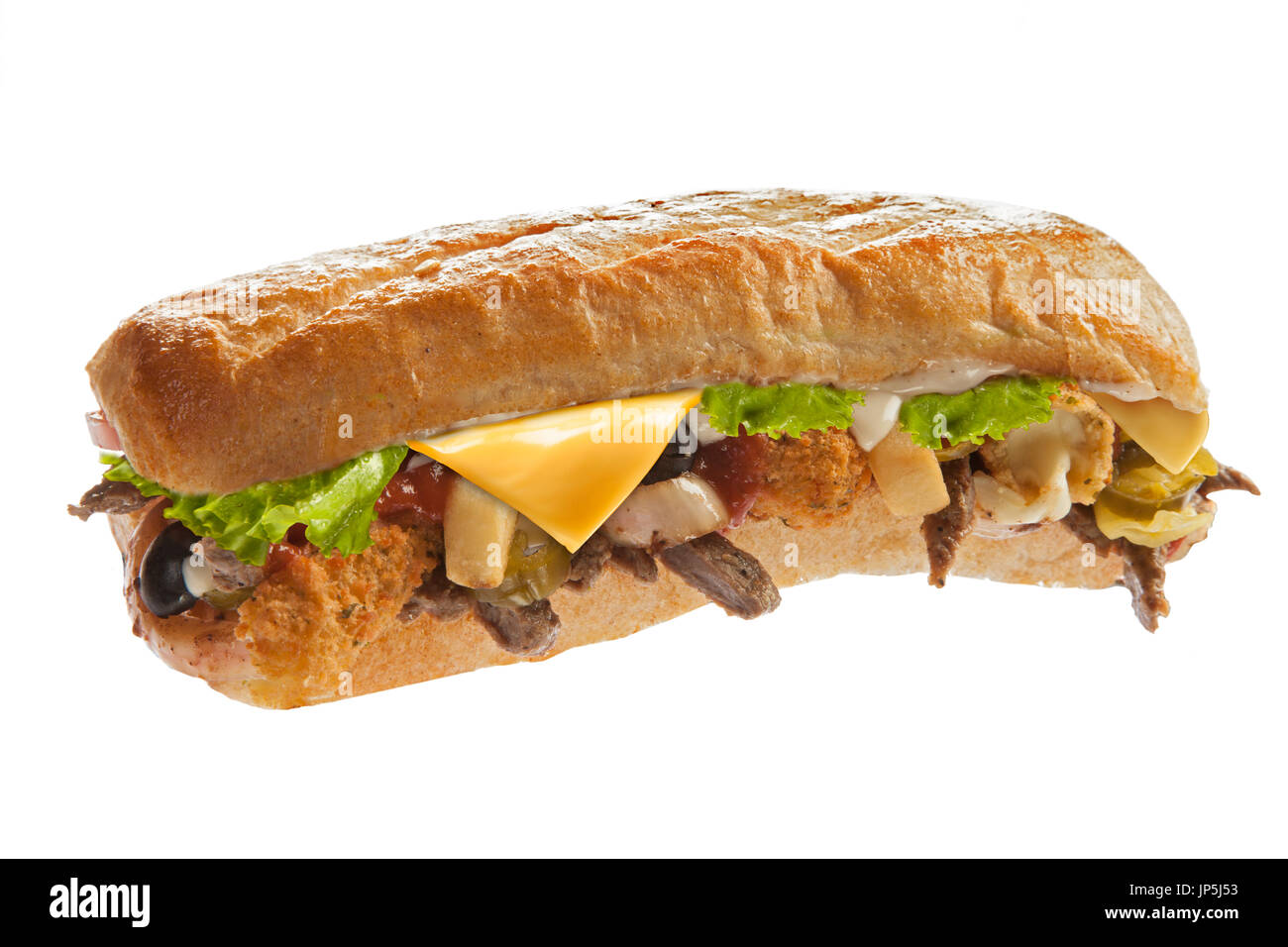 Mighty huge sub sandwich hoagie filled with veggies and meat - Stock Image
