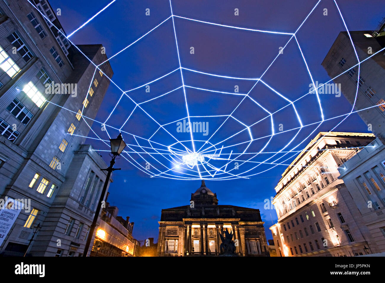 Ai Weiwei Spider lights up Exchange Flags at the rear of Liverpool Town Hall, a highlight of the Liverpool Biennial 2003. - Stock Image
