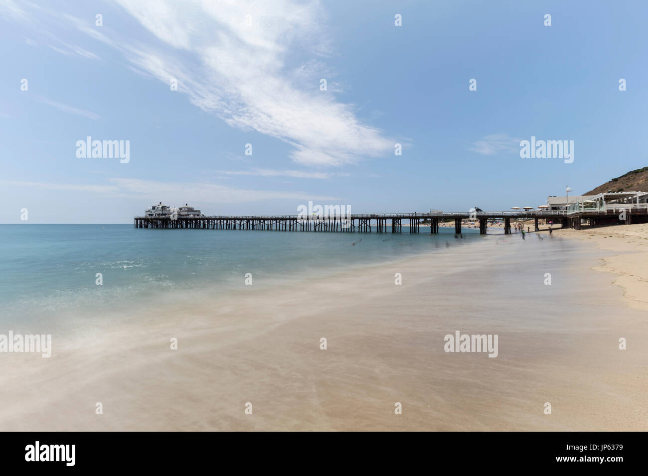 Malibu Pier beach with motion blur water in Los Angeles County, California. - Stock Image