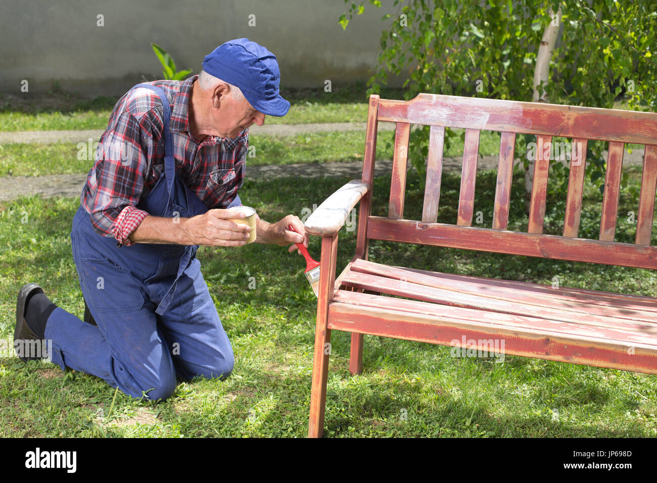 Prime Senior Man In Overalls Painting Old Bench In Garden After Machost Co Dining Chair Design Ideas Machostcouk