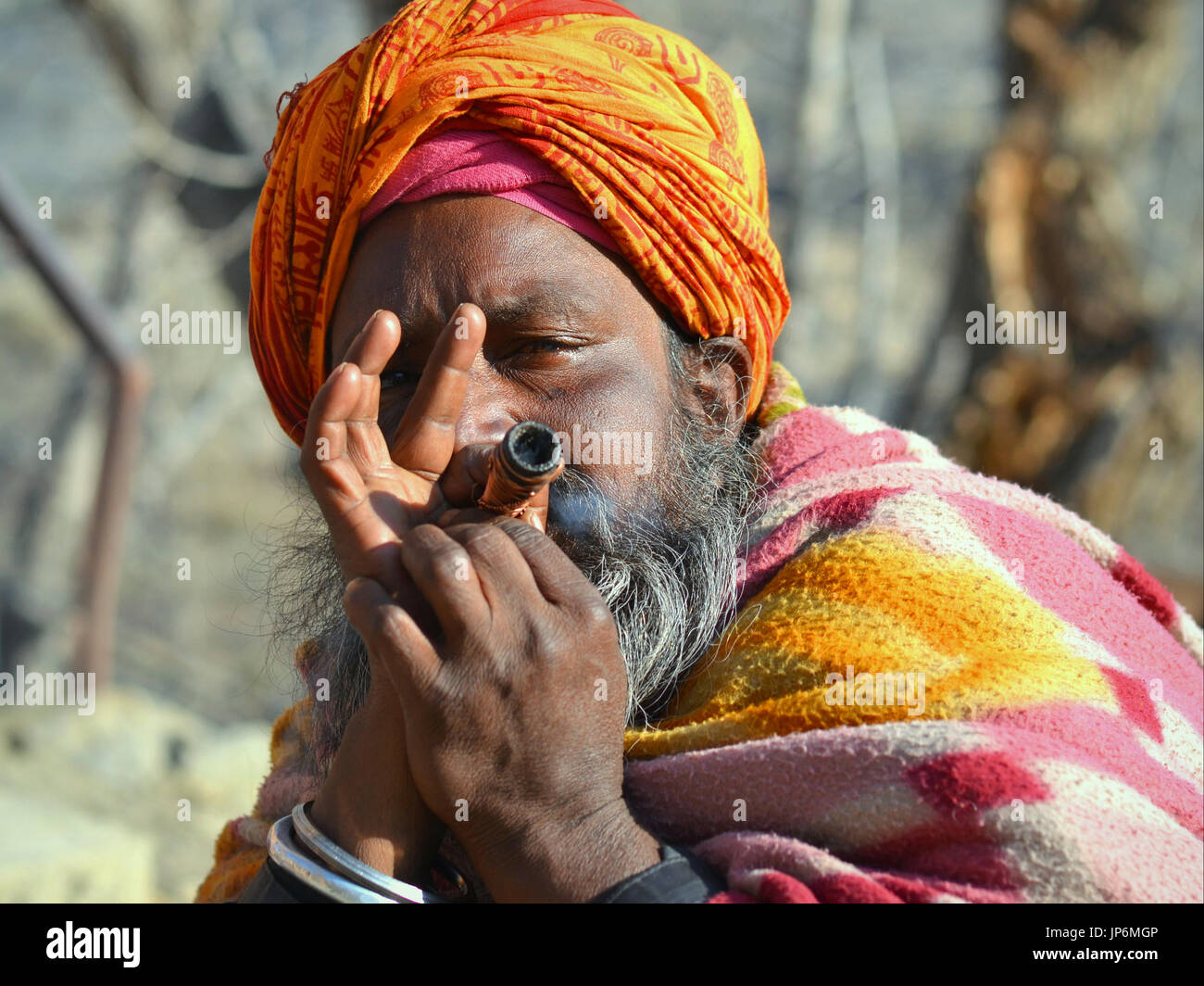 Nepalese Sadhu with Chillum Pipe, Muktinath. - Stock Image