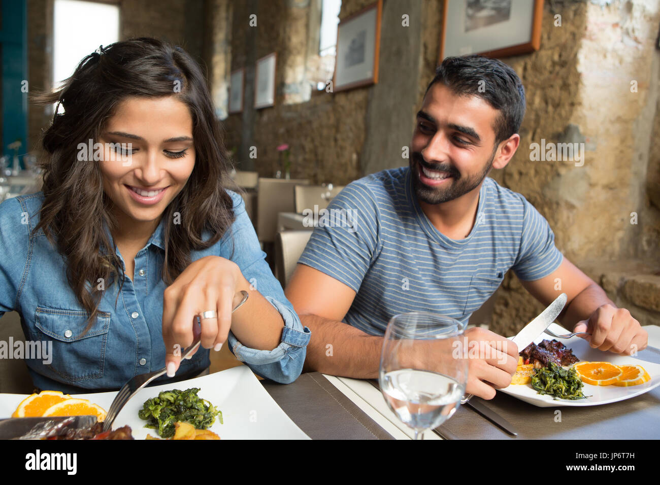Couple having lunch at rustic gourmet restaurant - Stock Image