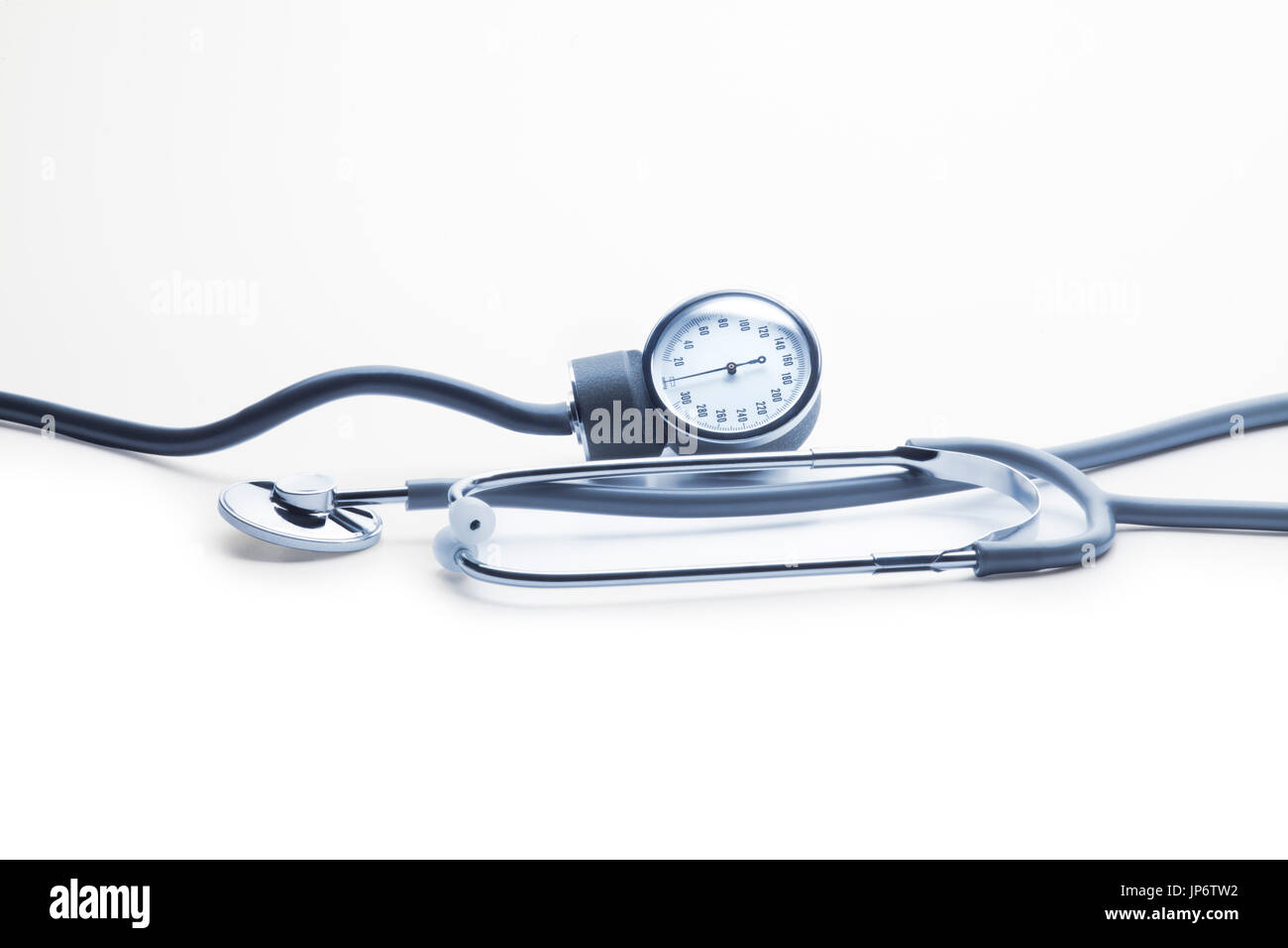 Blood pressure kit against white background. Pressure gauge and stethoscope. Horizontal set for banner use - Stock Image