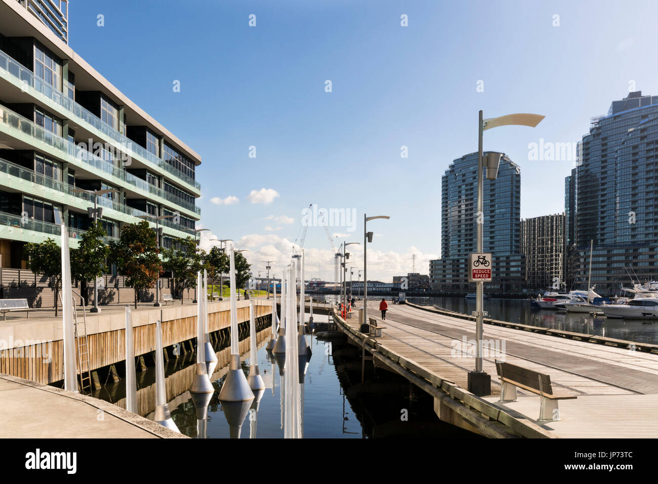 Docklands, Melbourne, Victoria, Australia. Waterfront buildings and marina, water and glass sparkling in sunshine. - Stock Image