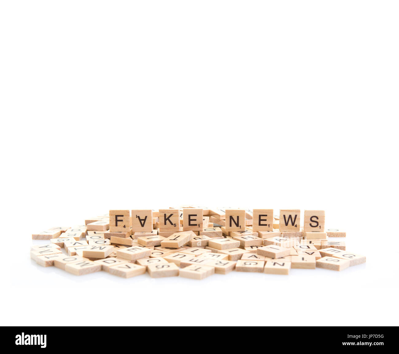 Fake News spelt out on word tiles on a white background. - Stock Image