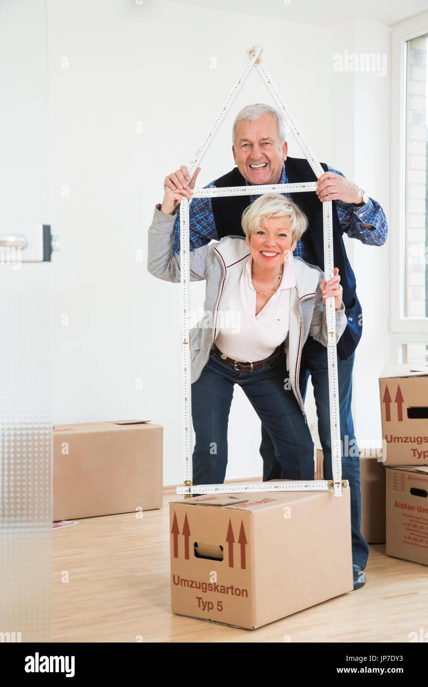 Senior couple moving houses Stock Photo
