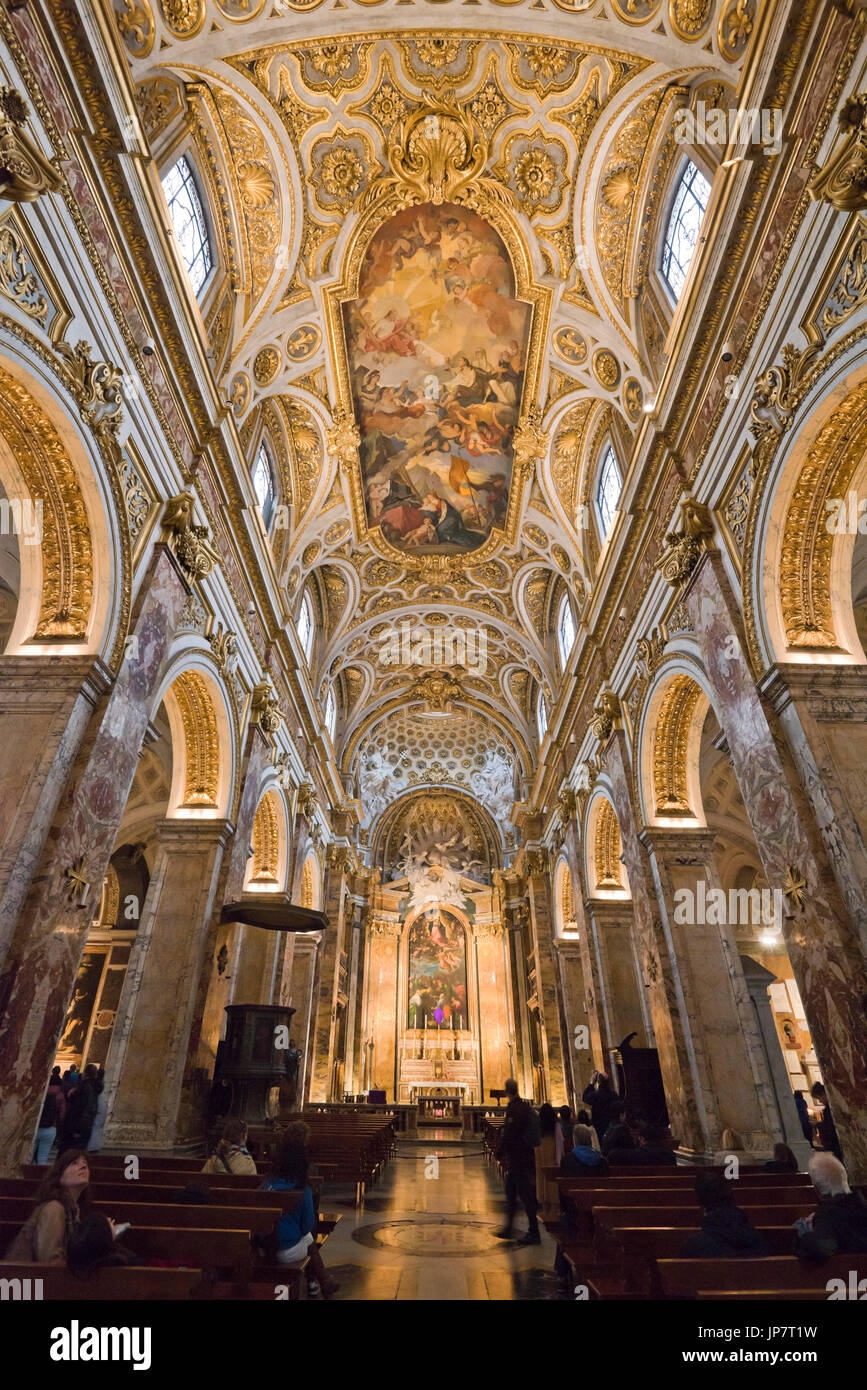 Vertical view of the high painted ceiling inside Chiesa di San Luigi dei Francesi in Rome. - Stock Image