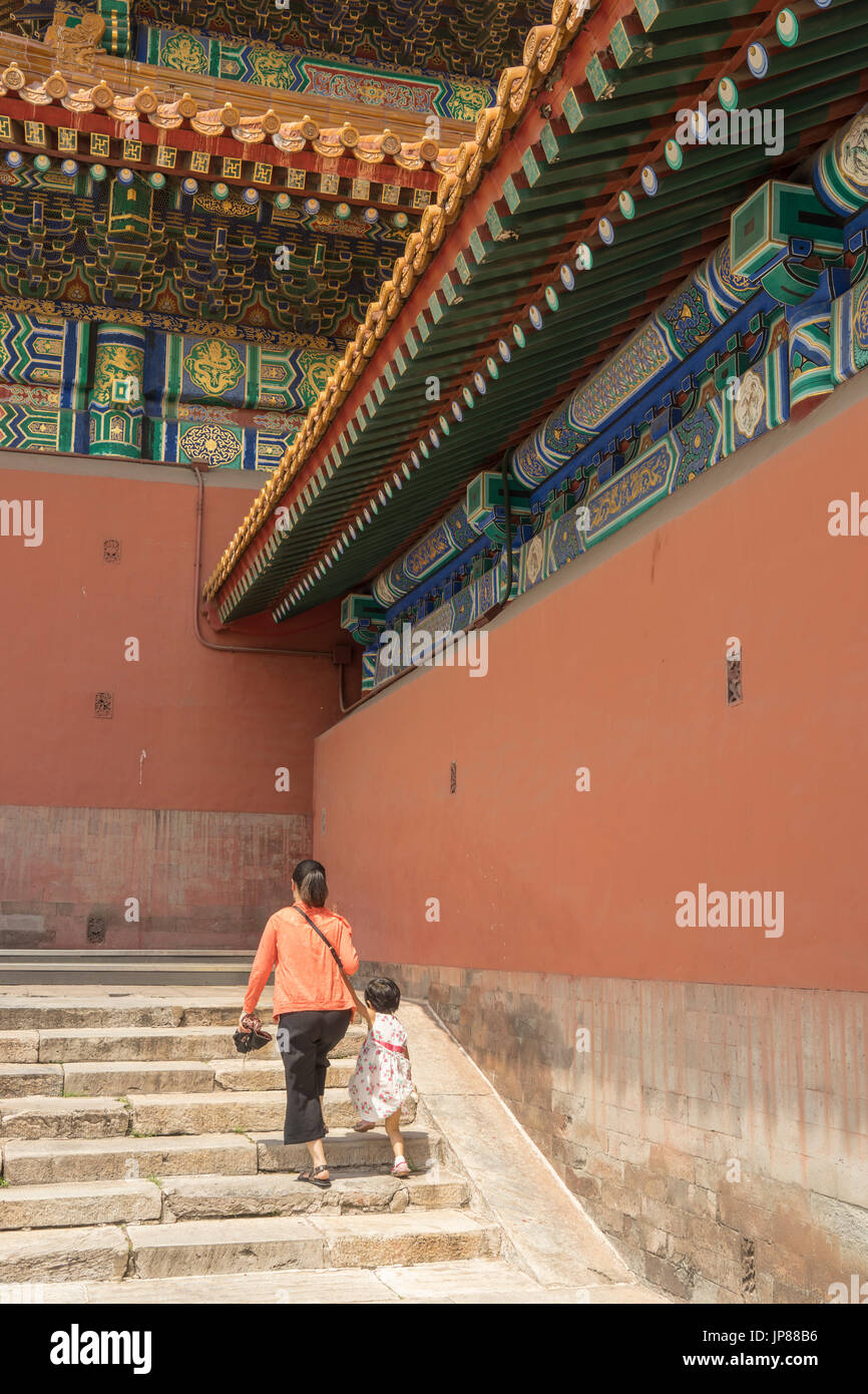 Mother and daughter tourists walking up steps at the Hall of Supreme Harmony in Forbidden City - Stock Image