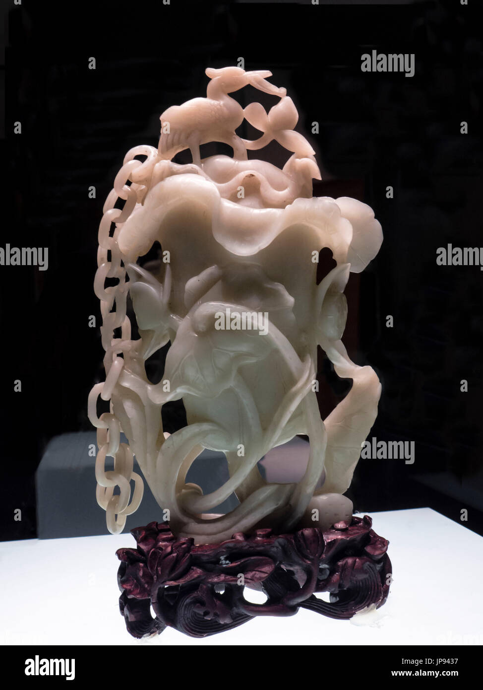 Overtop-handled Pot in the Shape of an Egret and Lotus Bloom, Greenish-white Jade, (1644 - 1911 AD) The Capital Museum, Beijing, China - Stock Image