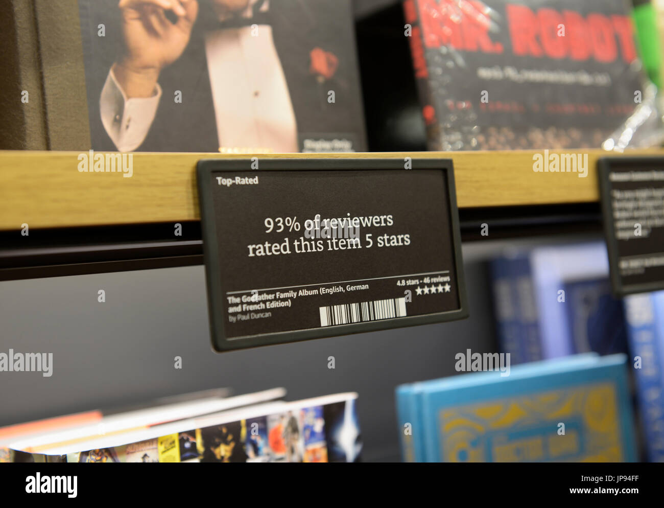 Books on shelves at an Amazon Books store with customer reviews and ratings , NJ - Stock Image