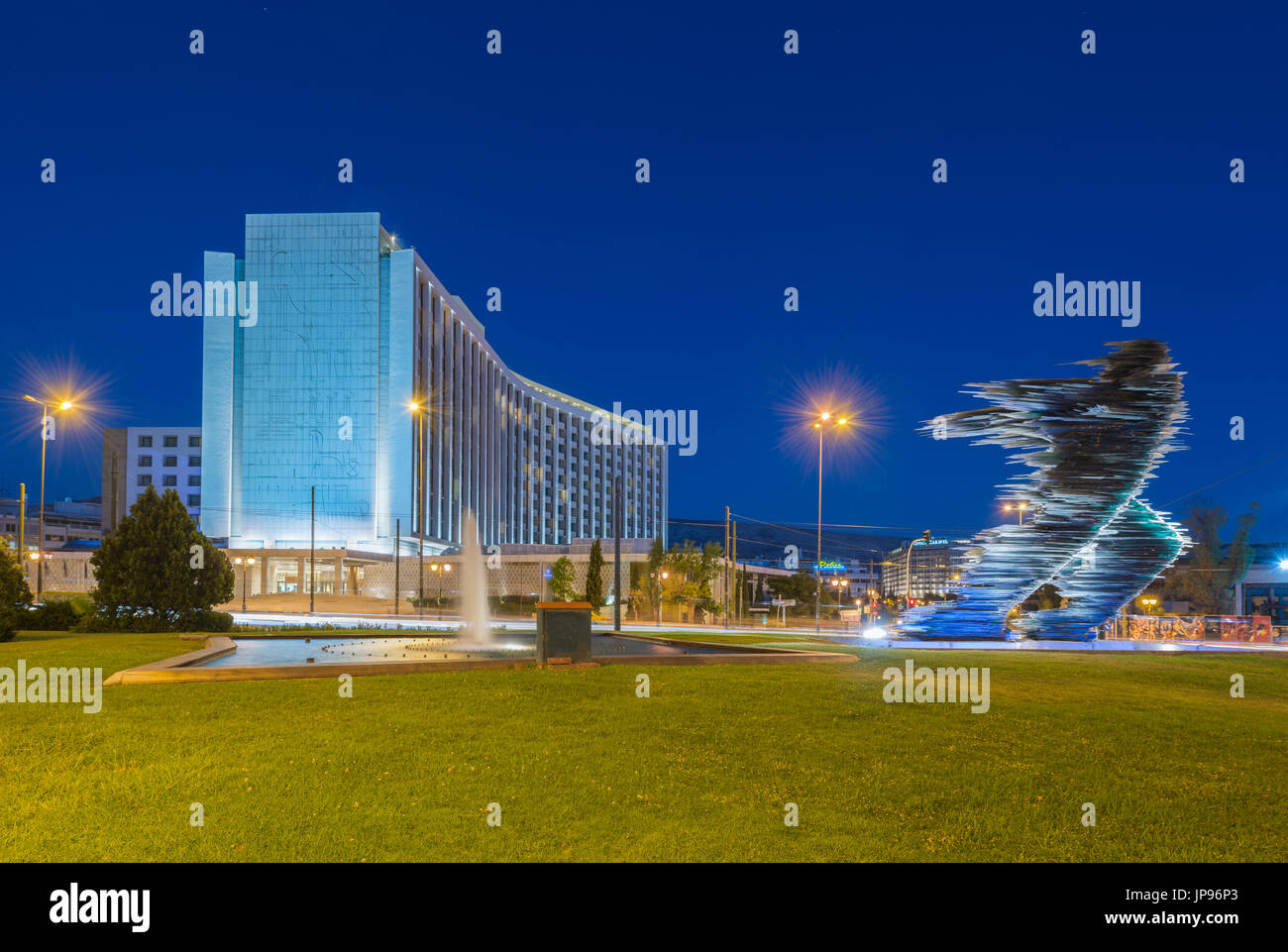 Statue of runner in front of hotel Hilton in Evangelismos in central Athens - Stock Image