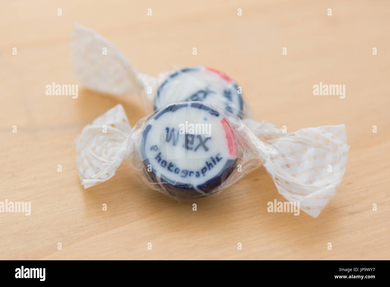 promotional rock sweets enclosed in online order from Wex photographic - Stock Image