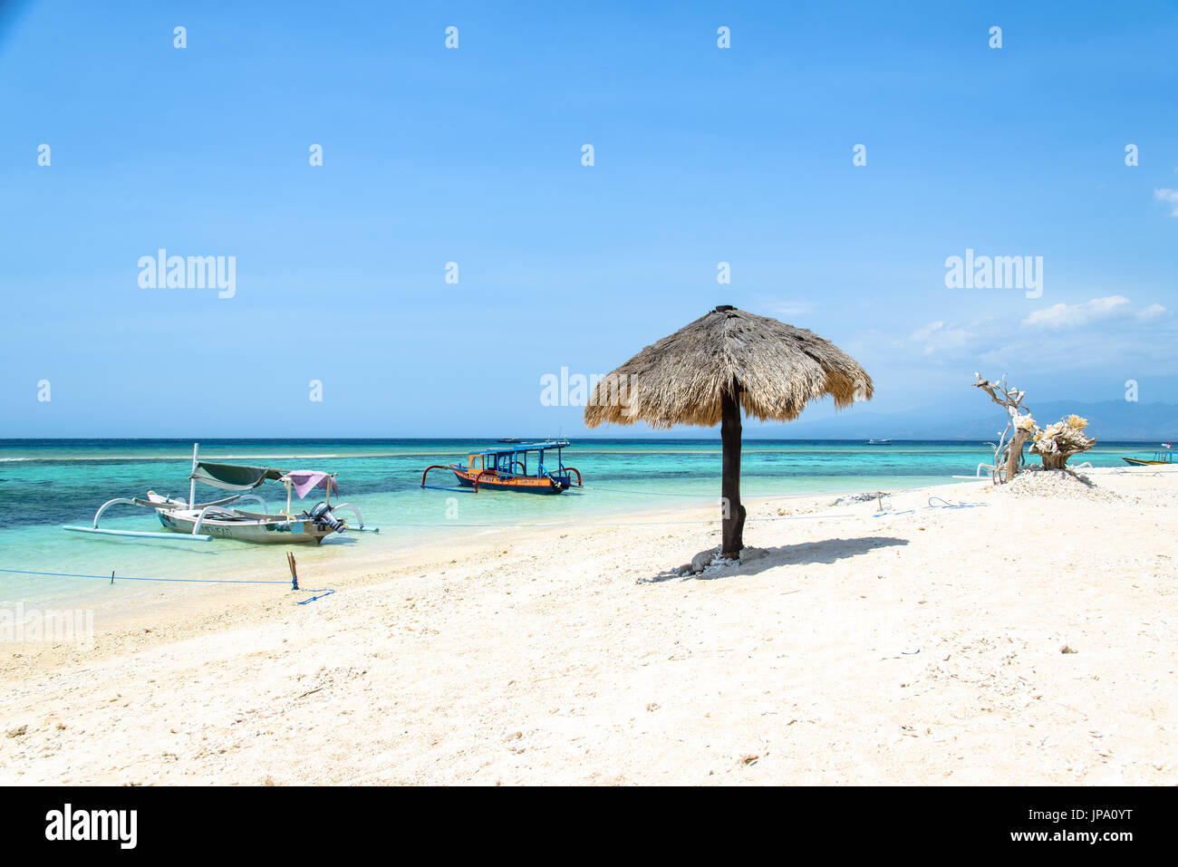 Beach of Gili Meno with crystal clear turquoise water, Lombok, Indonesia - Stock Image