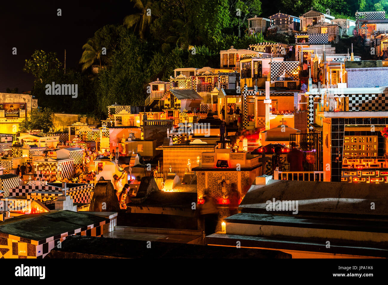 MORNE-A-L'EAU, GUADELOUPE - NOVEMBER 01, 2015: Cemetery in 'Morne-à-l'Eau', Guadeloupe. with lighted candles on All Saints' Day - Stock Image