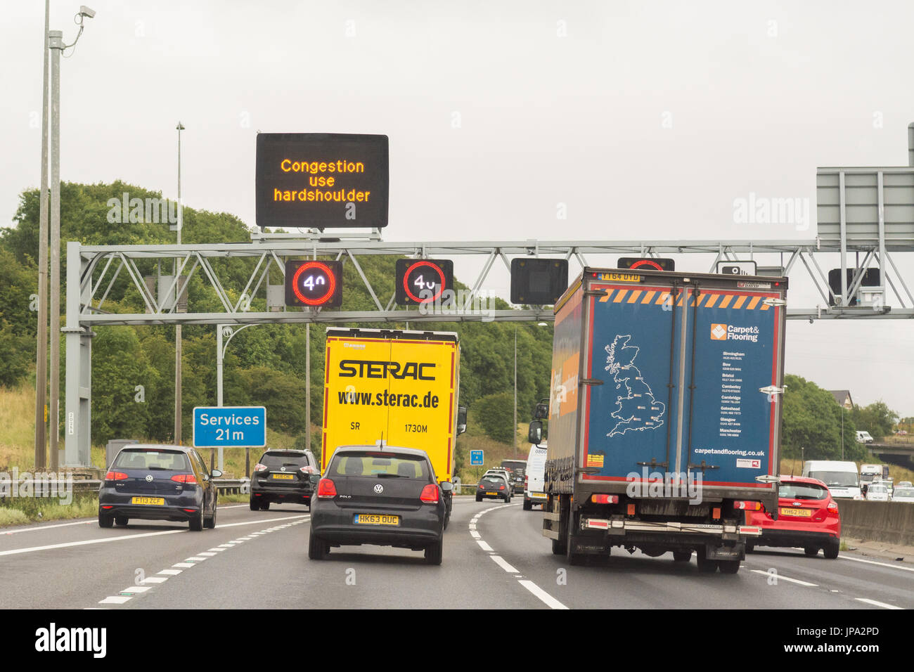 Smart Motorway M6 - UK - congestion use hard shoulder sign - Stock Image